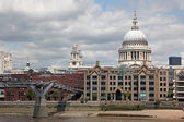 St. Paul's Cathedral and Millennium Bridge in London — Stock Photo