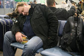 Man Sleeps In Airport — Stock Photo