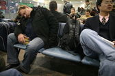 Man Sleeps In Airport — Stock Photo
