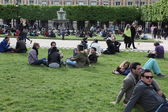 Young people on the lawn in front of the university — Stock Photo
