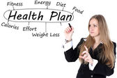 Woman drawing plan of Health — Stock Photo