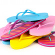 Pile of Colorful Flip Flops Isolated on White — Stock Photo #14874353