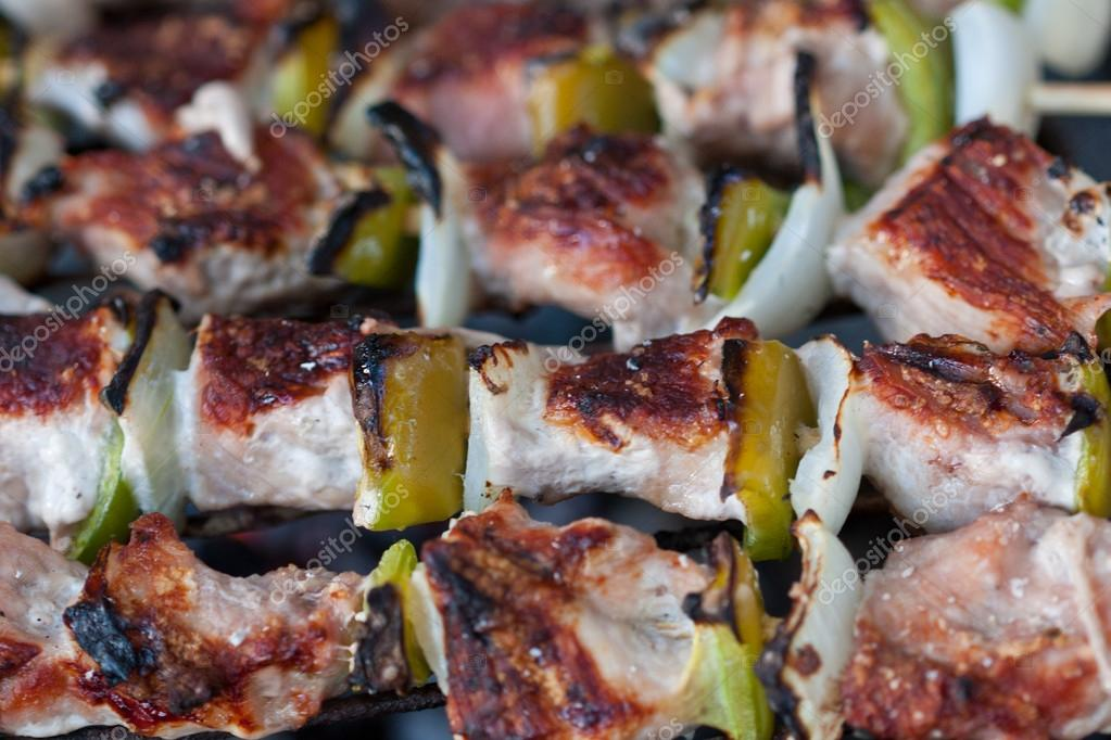 Grilled meat on skewers cooking on a coal. — Stock Photo #13545572