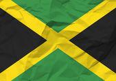Crumpled paper Jamaica flag — Stock Vector