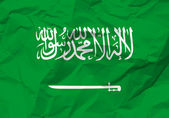 Crumpled paper Saudi Arabia flag — Stock Vector