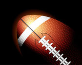 Football ball on black — Stock Vector