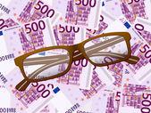 Reading glasses on five hundred euro background — Stock Vector