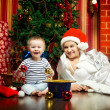 Mother and Baby Near Christmas Three — Stock Photo #18984721