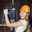 Beautiful Woman With Heavy Drill — Stock Photo #19292597