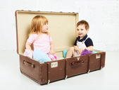 Boy and Girl in Suitcase — Stock Photo