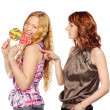 Two Women with Lollipop — Stock Photo #25276173