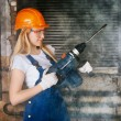 Beautiful Woman With Heavy Drill — Stock Photo #35050721