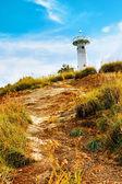Farol em uma colina — Foto Stock