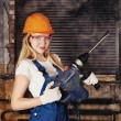 Beautiful Woman With Heavy Drill — Stock Photo #35064309