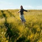 Happy woman in field — Stock Photo #7229200