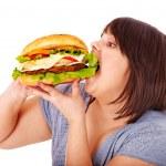 Woman eating hamburger. — Stock Photo #11295326