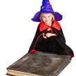 Witch girl holding book. — Stock Photo #12069960