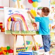 Child painting at easel. — Stock Photo #12071373