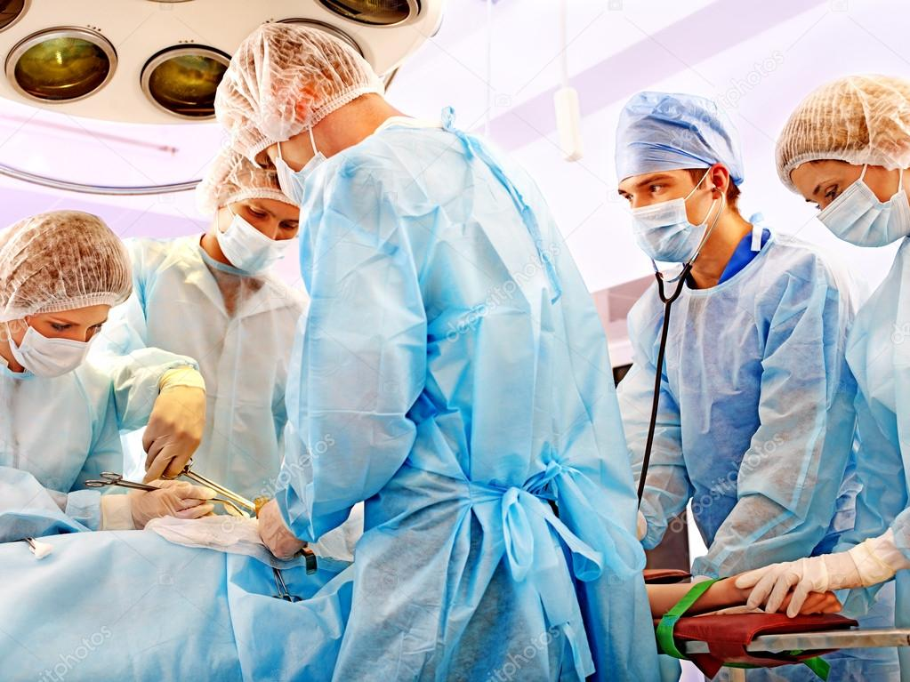 Team surgeon at work in operating room. — Stock Photo #12070892