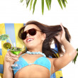 Girl in bikini drinking cocktail. - Stock Photo