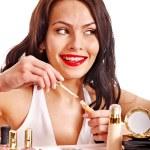 Girl holding eyeshadow and makeup brush. — Stock Photo