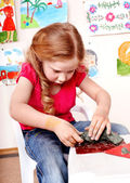 Child playing plasticine. — Stock Photo
