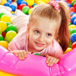 Child in colored ball. - Stock Photo