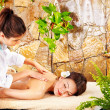 Young woman getting massage in spa. - ストック写真