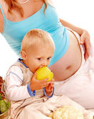 Pregnant woman and kid . — Stock Photo