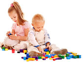 Children play building blocks. — Stock Photo