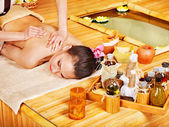 Beautiful young woman getting massage in spa — Stock Photo
