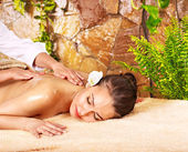 Young woman getting massage in spa. — Stock Photo