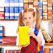 Child with book on bookshelf. — Stock Photo #12242151