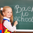 Stock Photo: Child writting on blackboard.