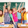 Stock Photo: Group of school child in classroom.