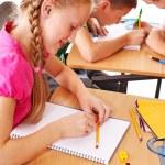 School child sitting in classroom. — Stock Photo #12242271