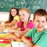 School child writting on blackboard. — Stock Photo #12242287