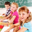 Stock Photo: School child sitting in classroom.