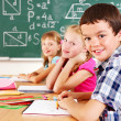 School child sitting in classroom. — Stock Photo #12242297