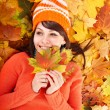Young woman in autumn orange leaves. — Stock Photo #12242320