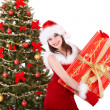 Christmas girl in santa holding gift box. - Stockfoto