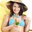 Girl in bikini drinking orange juice. — Stock Photo #12242345