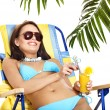 Girl in bikini drinking cocktail. — Stock Photo #12242346