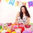 Stock Photo: Woman holding gift box at birthday party.