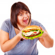 Woman eating hamburger. — Stock Photo #12242505