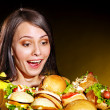 Woman holding hamburger. - Stock Photo