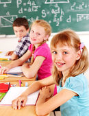 School child sitting in classroom. — Stock Photo