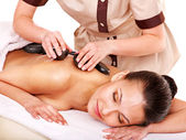 Woman getting stone therapy massage . — Photo