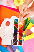 Hand with paintbox. — Stock Photo