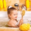 Child washing in bubble bath . - Foto Stock